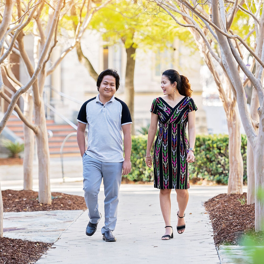 Two people walking and talking together